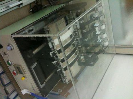 耐摩擦性検査装置